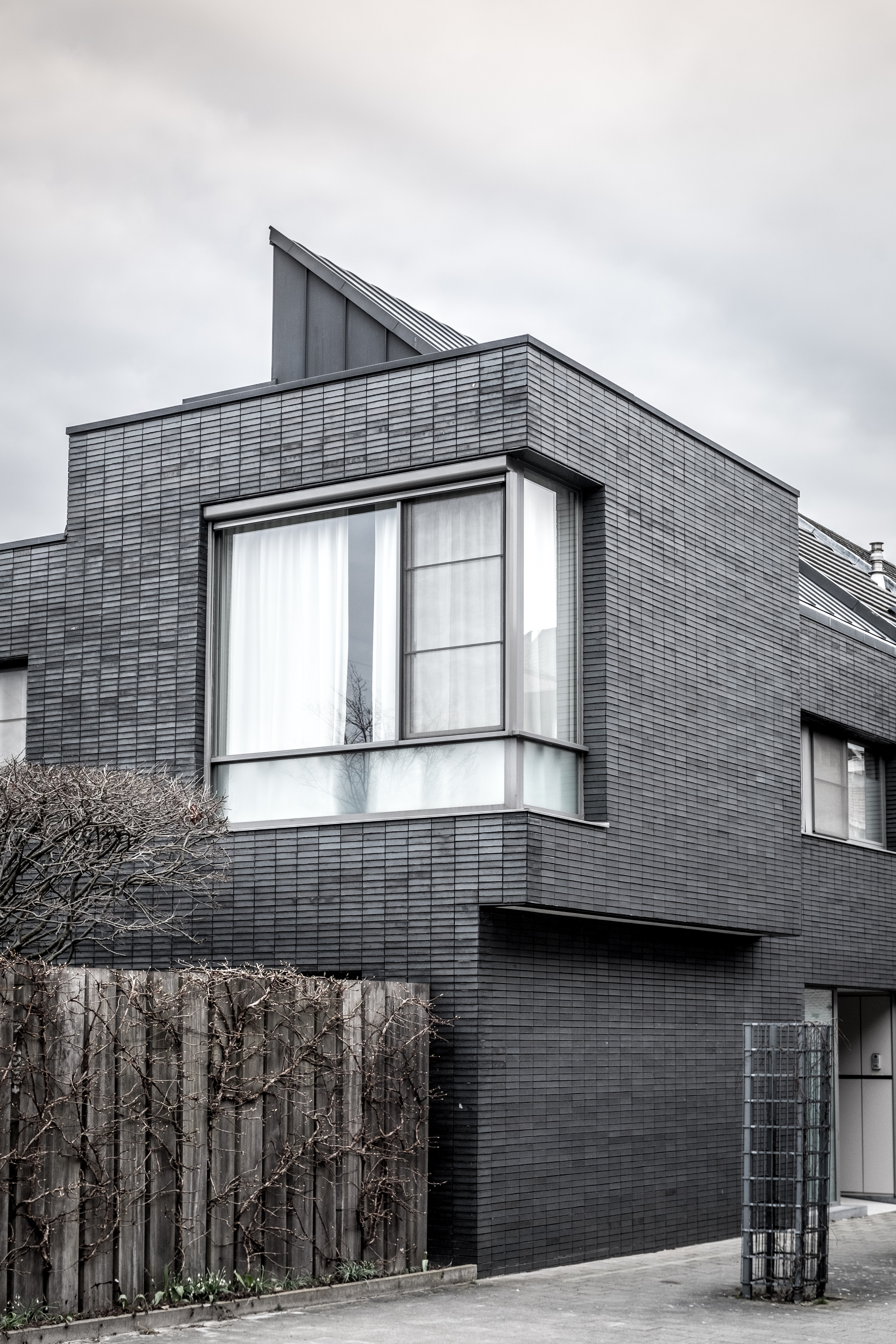 grayscale photography of 2-storey house