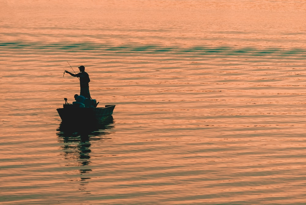 person on boat fishing