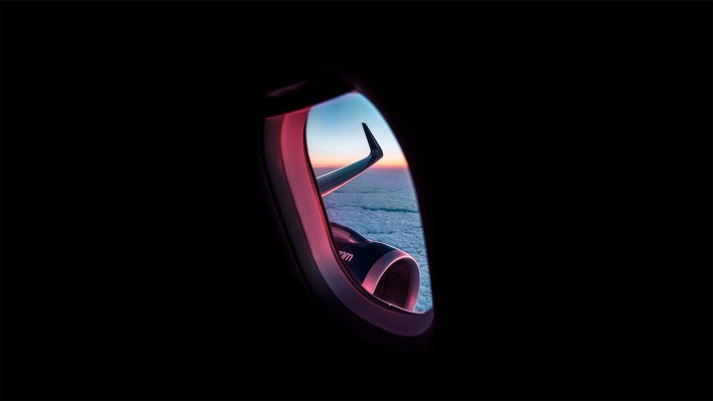 photograph of sea through airplane window