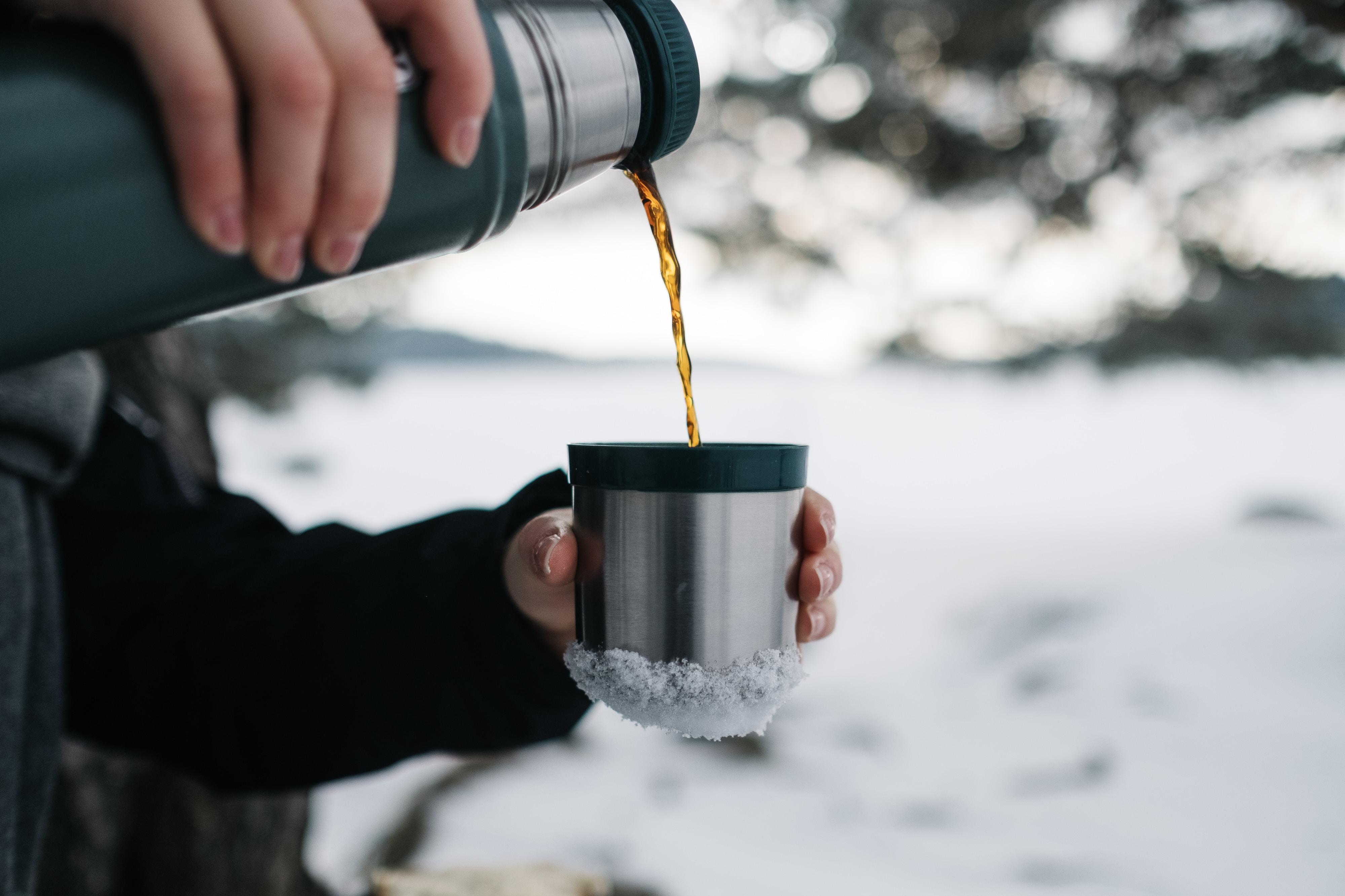 person pouring a mug