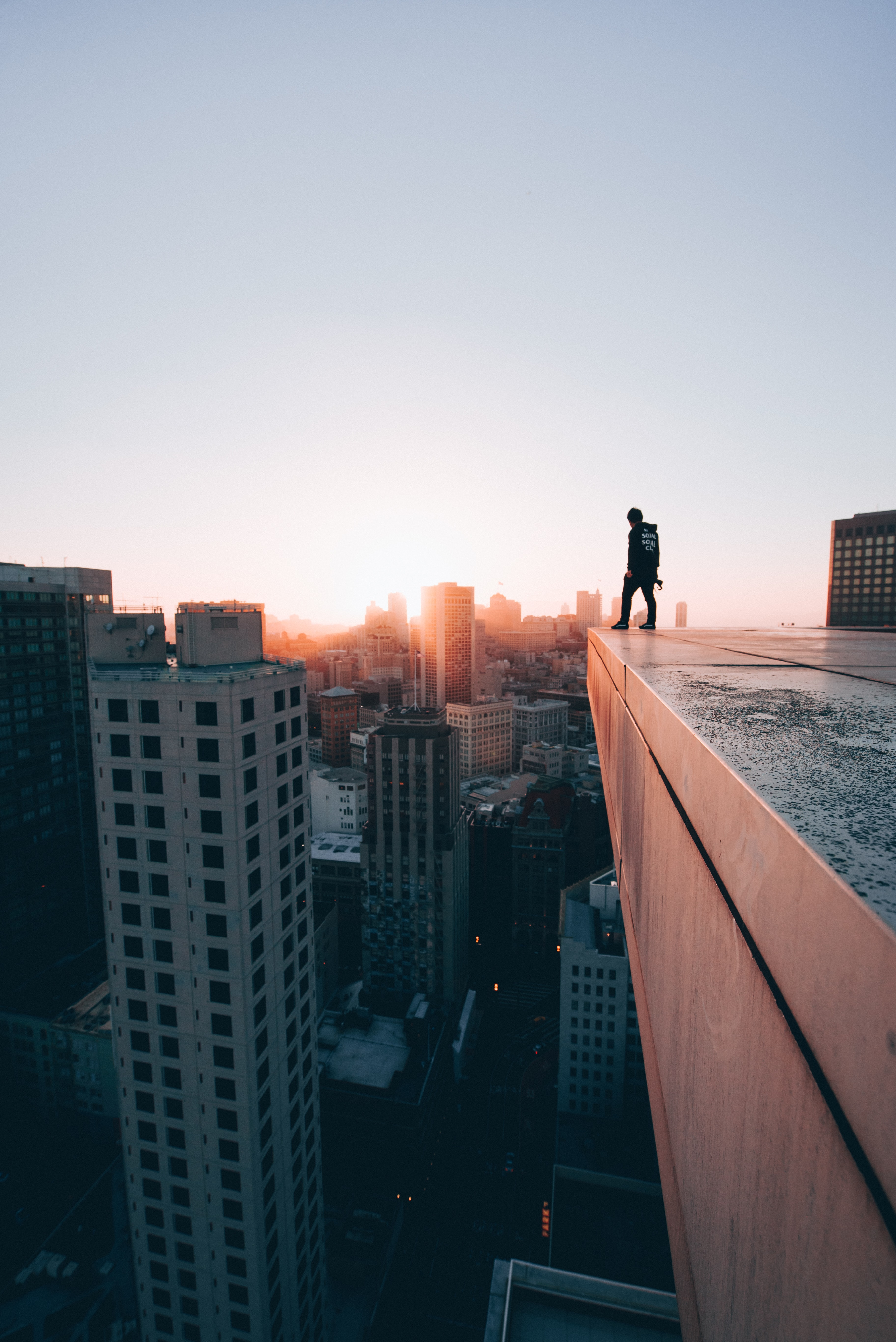 man standing on edge of the building
