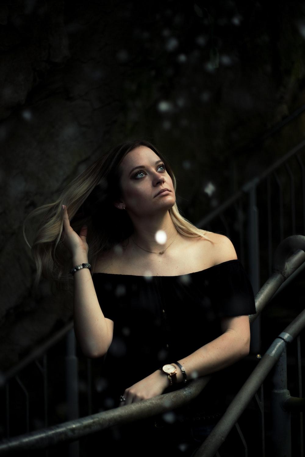 woman in black off-shoulder dress