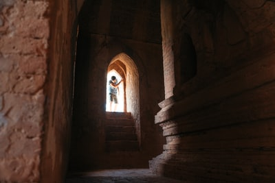 Guy Entering Temple Made of Brick
