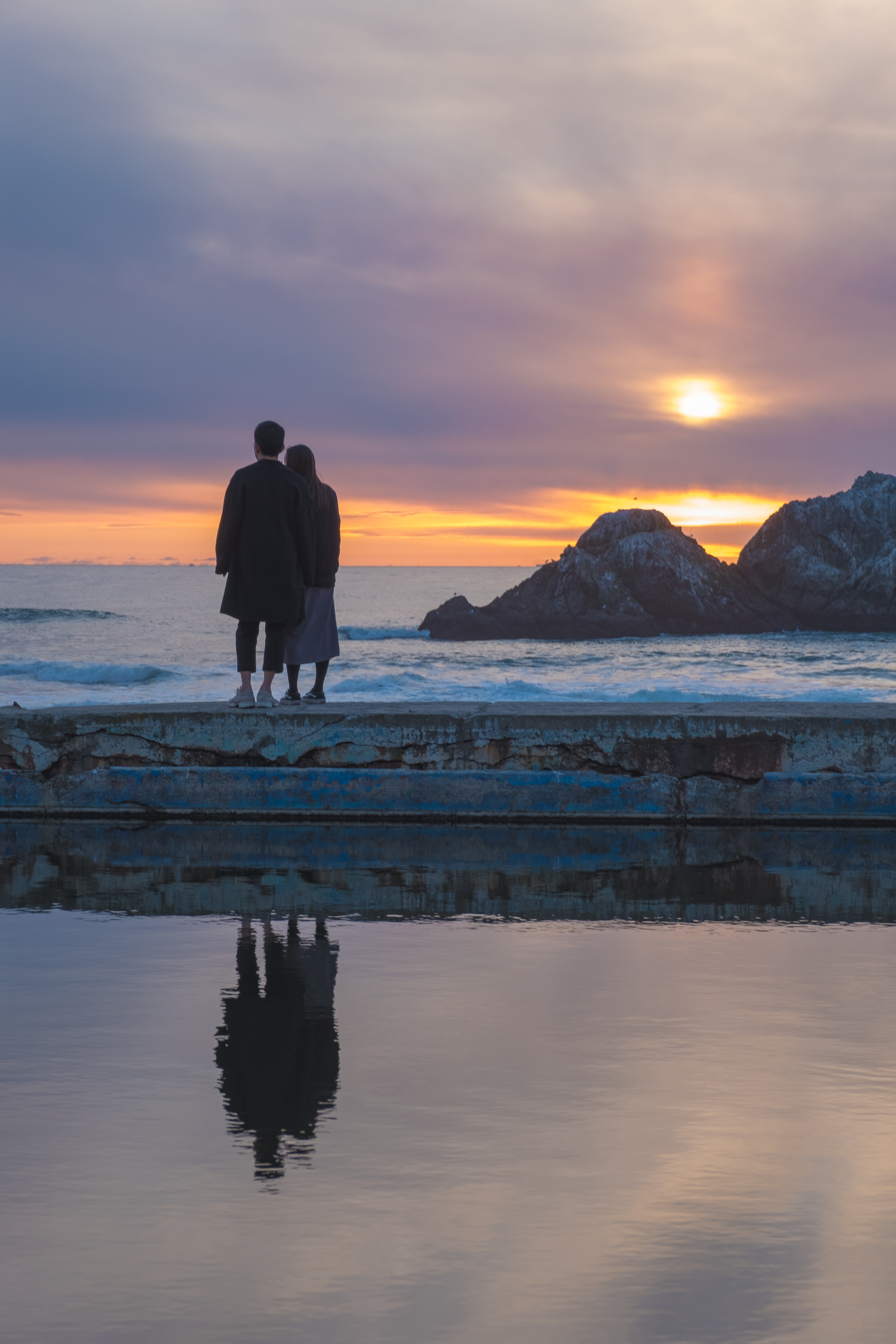couple on seashore during golden hour