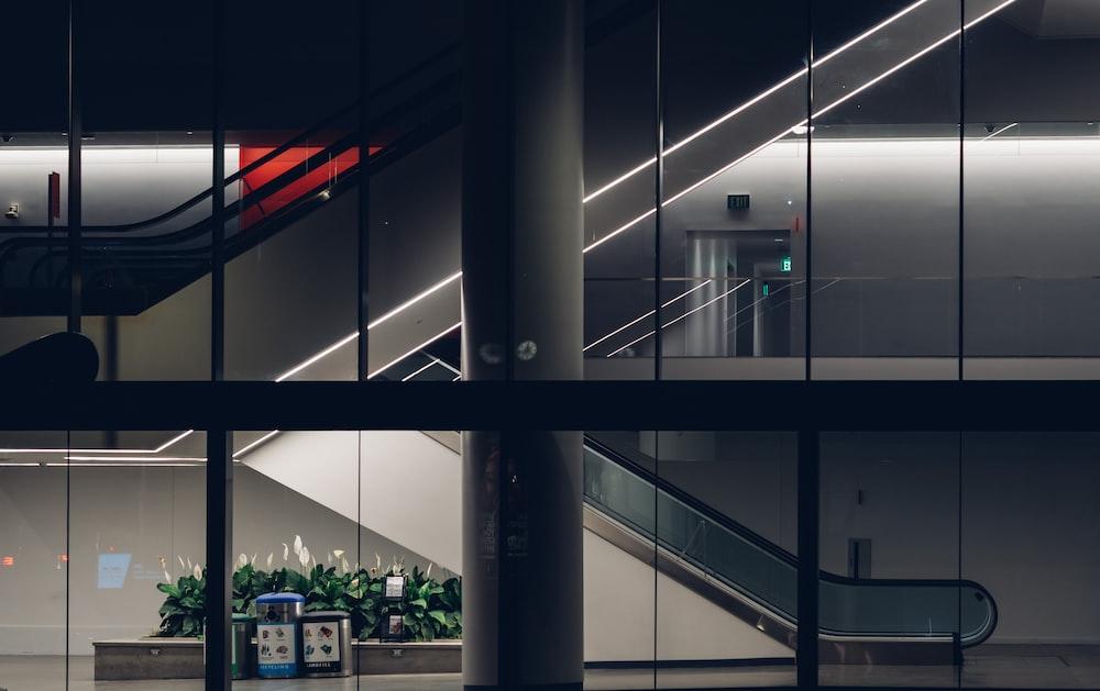 white and black building escalator