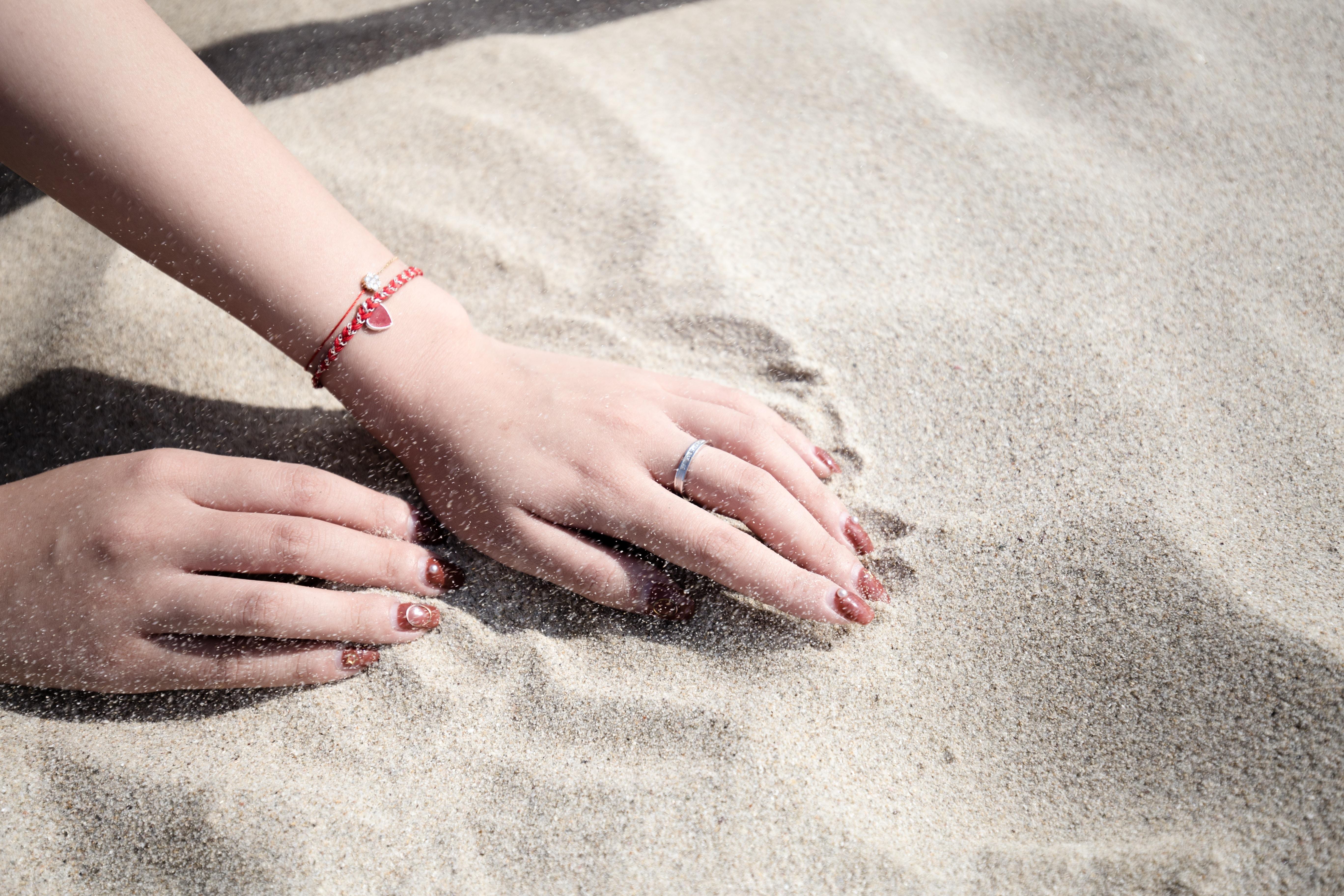 woman lying on white sand