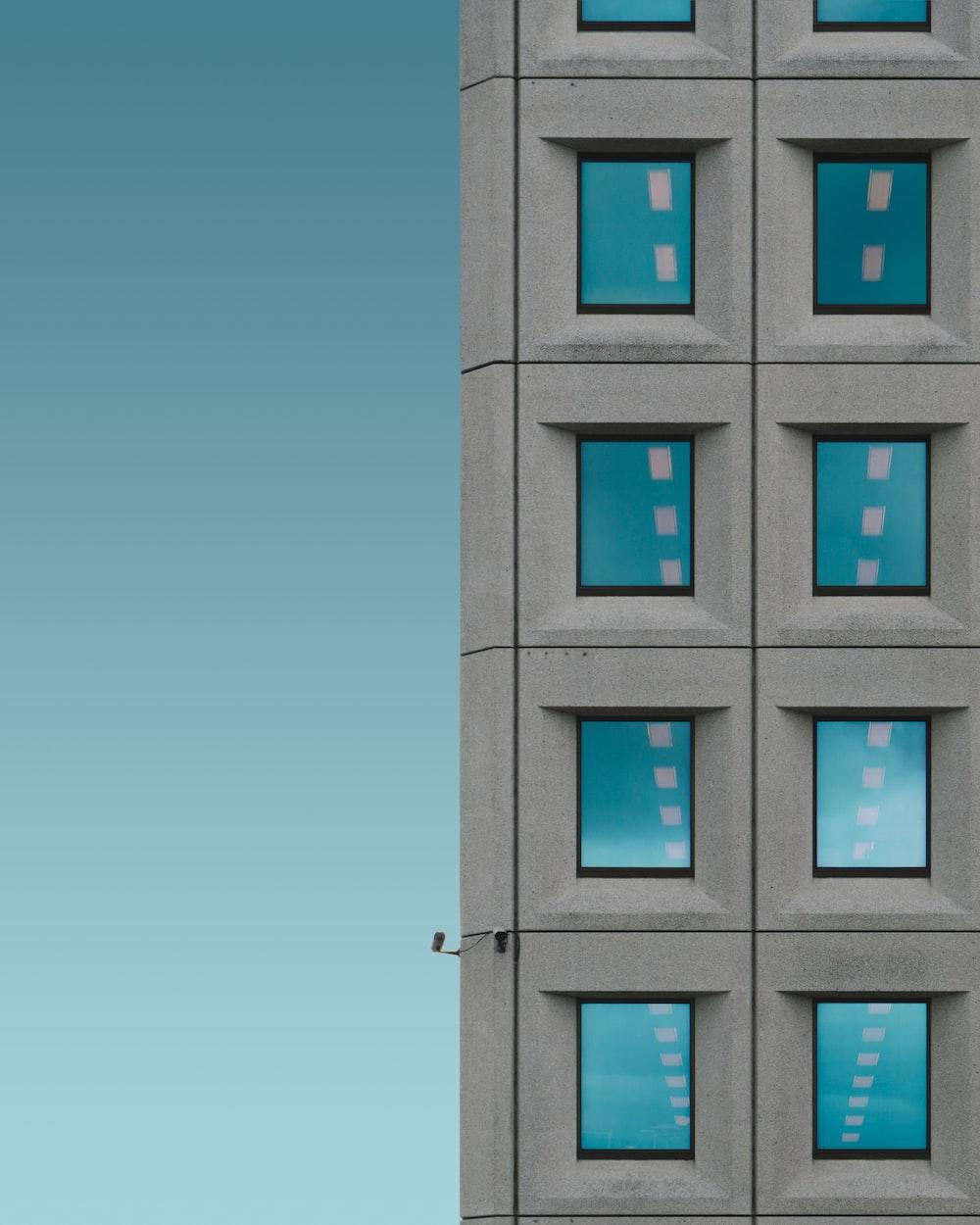 grey concrete building with security cameras