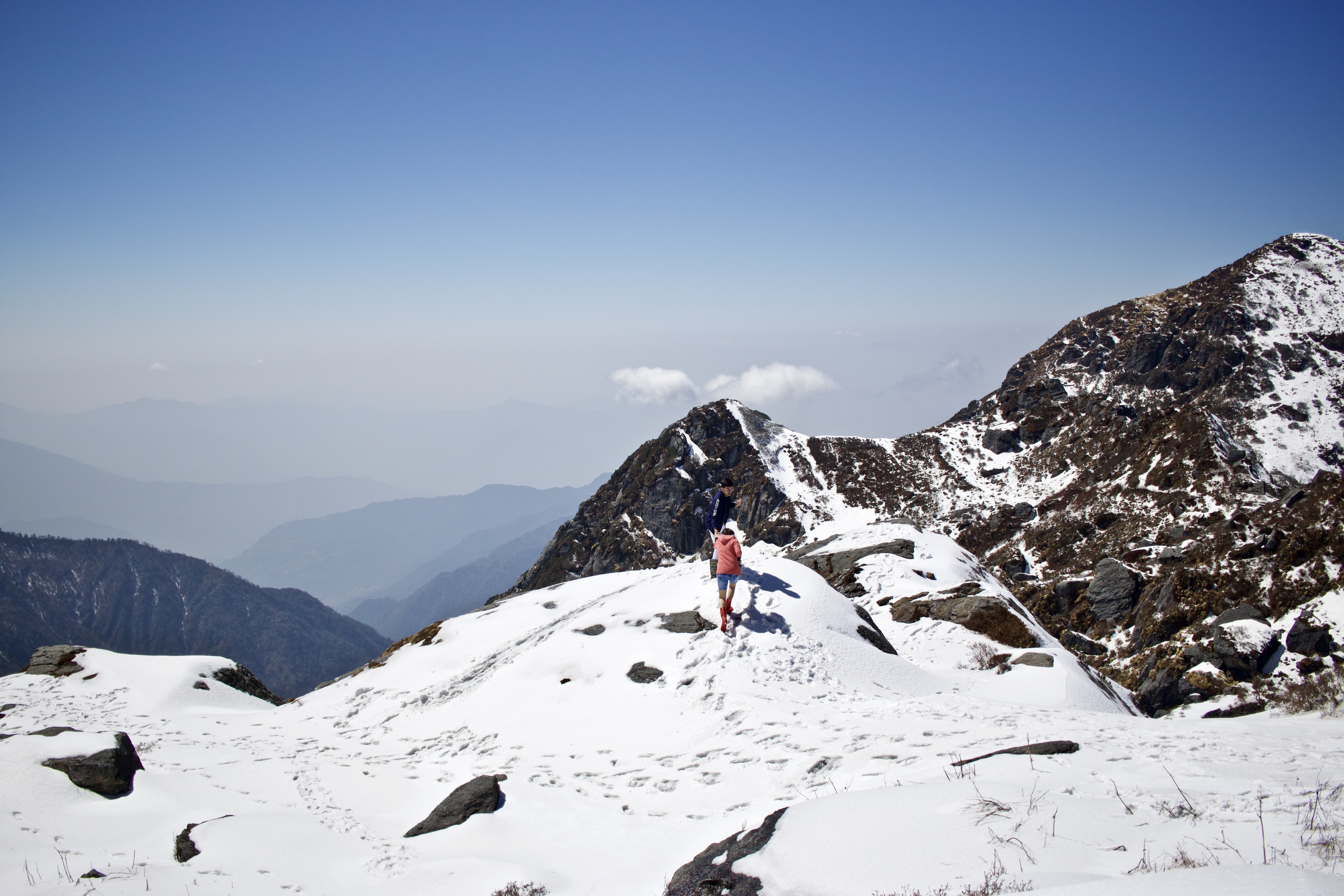 person about to climb snowy mountain