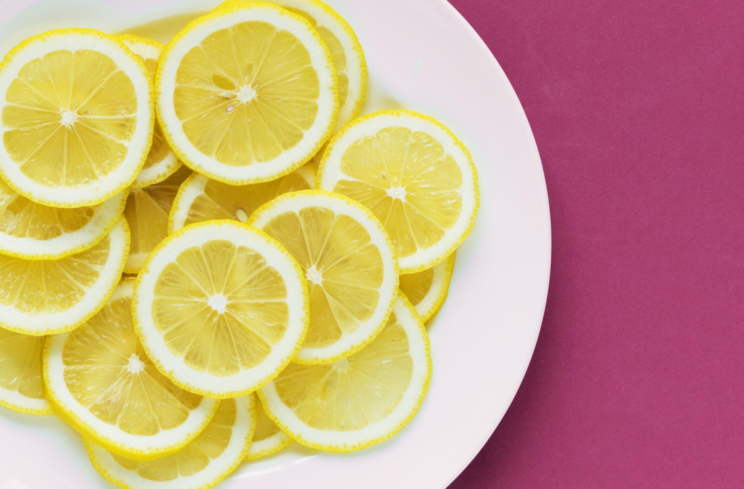 sliced lemon on white ceramic plate