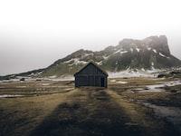 brown wooden cabin near mountain