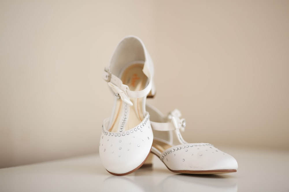 pair of women's white kitten heels