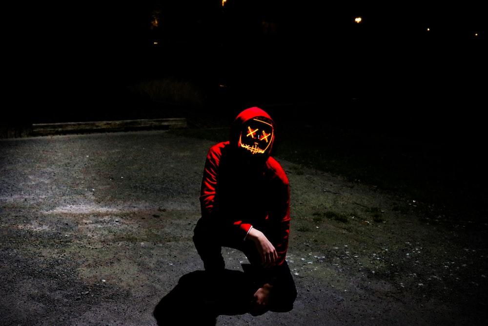 man kneeling outdoors