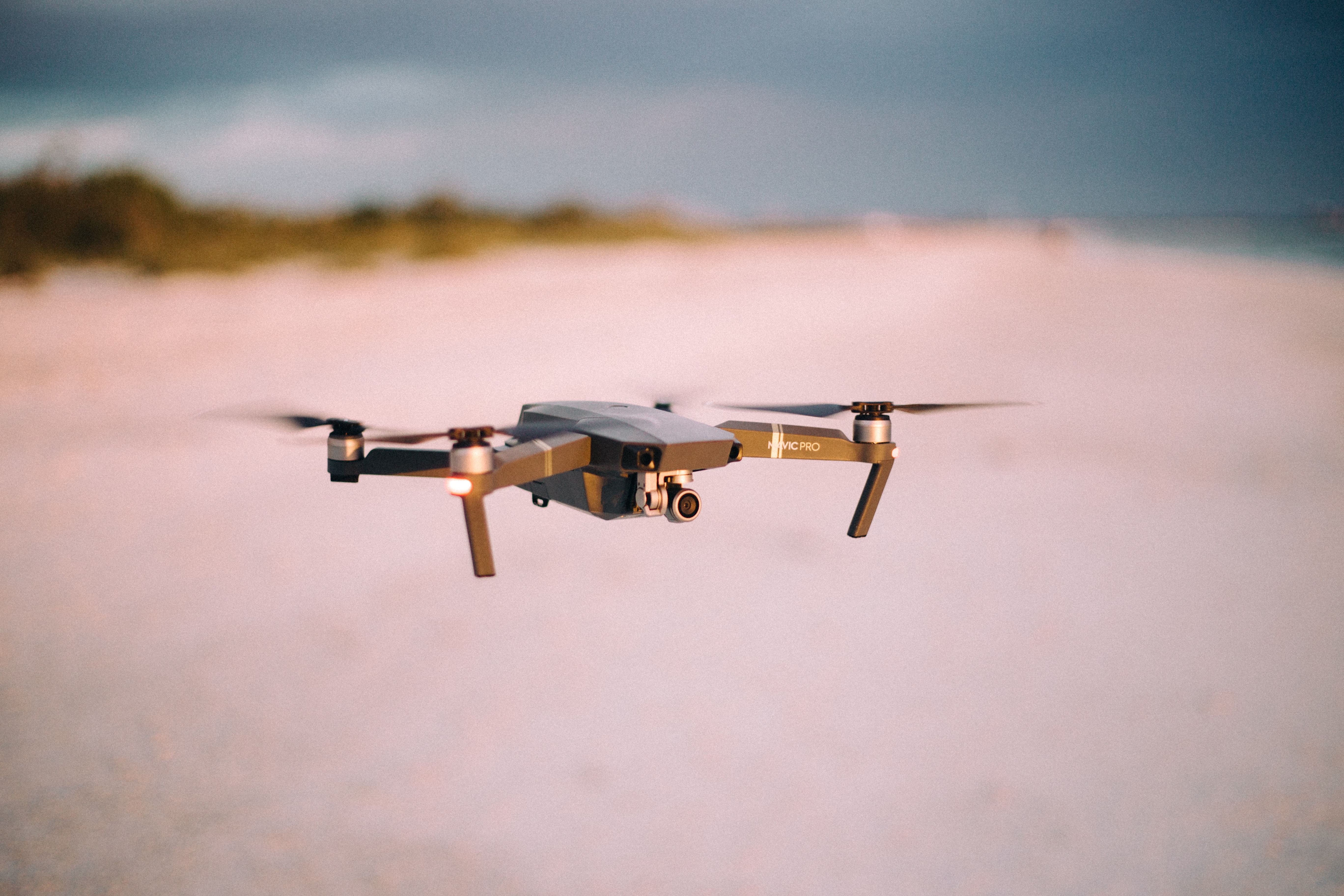shallow focus photography of flying quadcopter