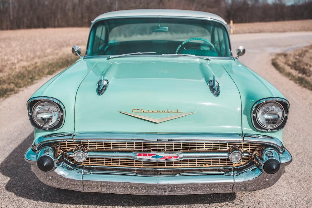 vintage green car on road