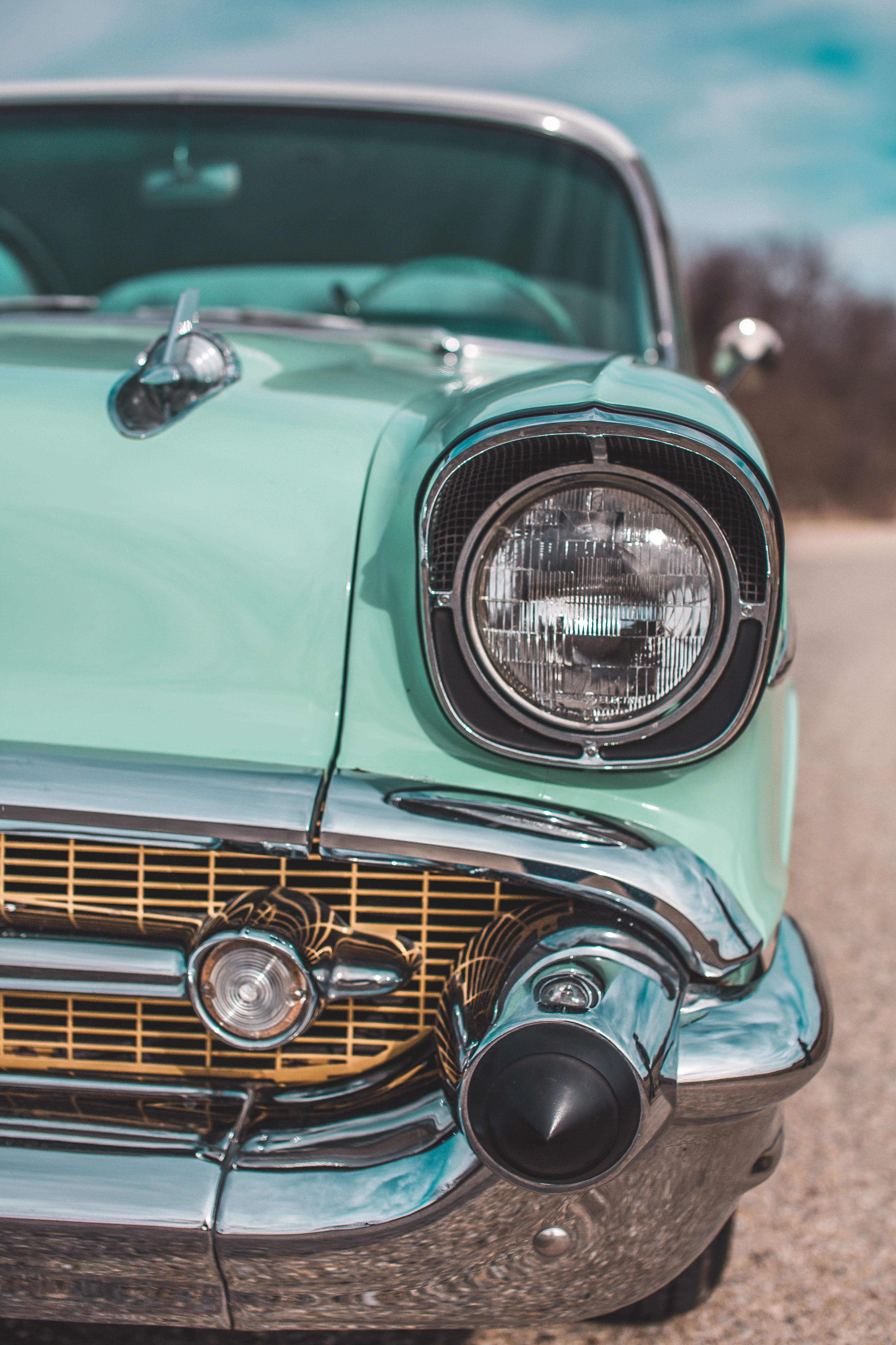 close-up photography of classic teal car