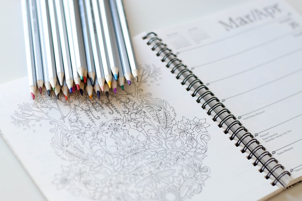 coloring pencils on notebook