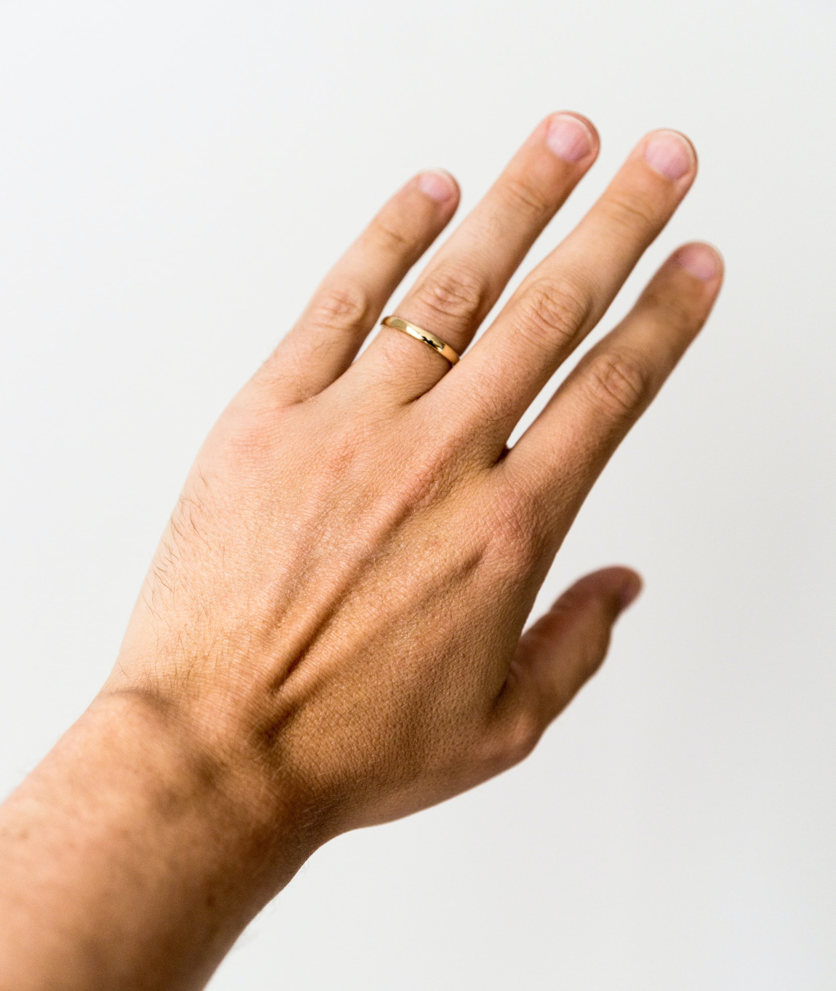 person showing gold-colored ring