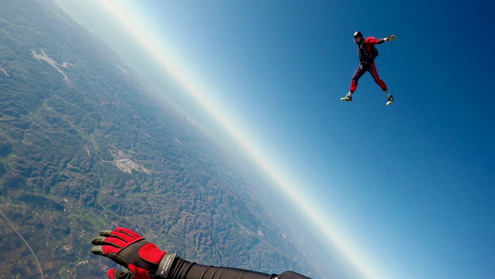 man in red and black outfit air diving