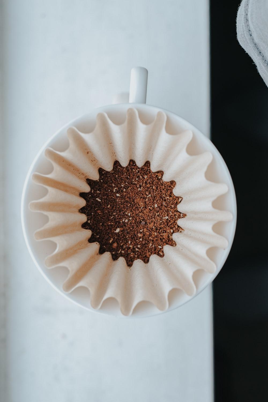 white muffin tray on top of white ceramic mug