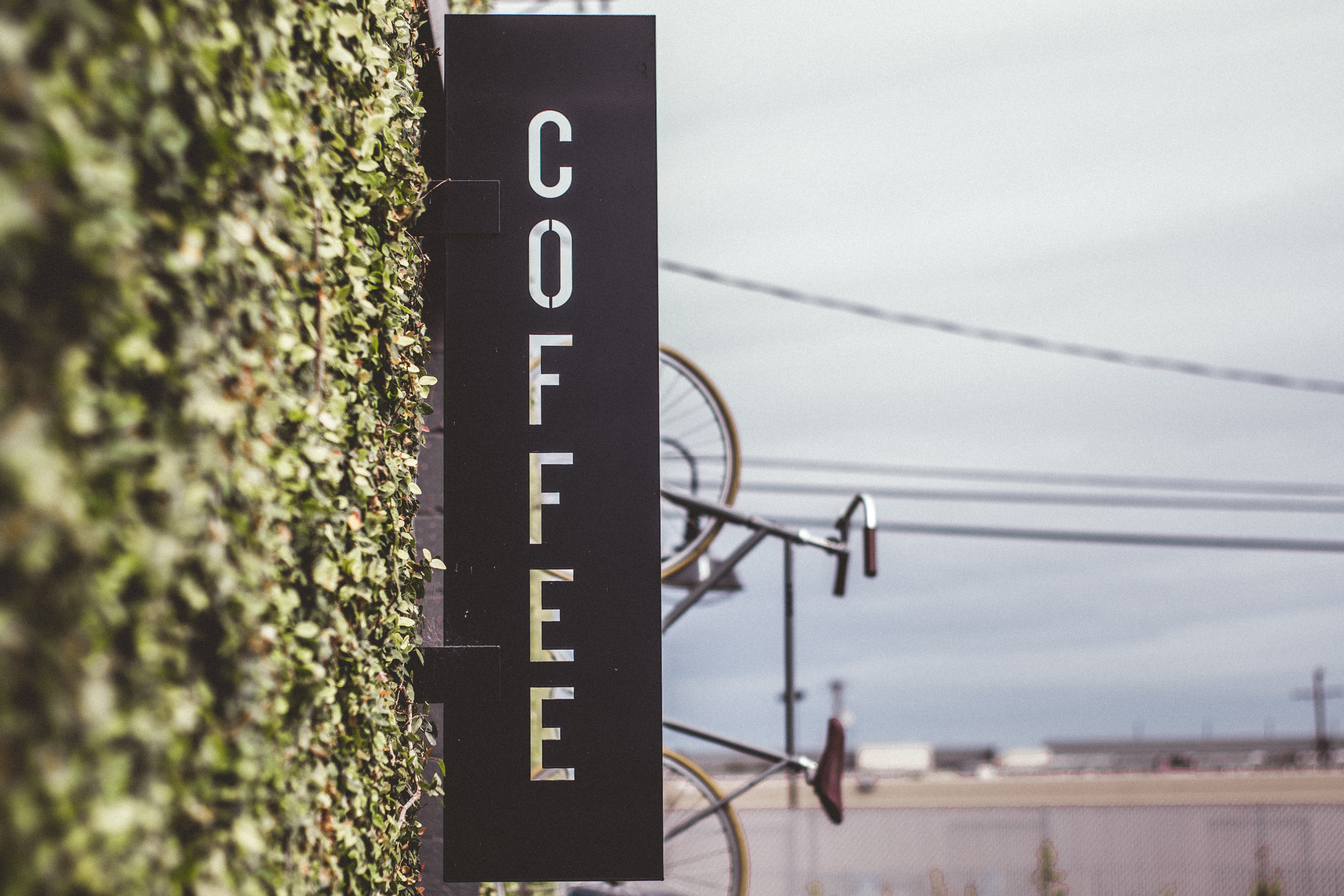coffee signage beside bicycle