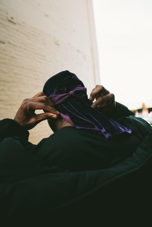 person putting on purple headdress