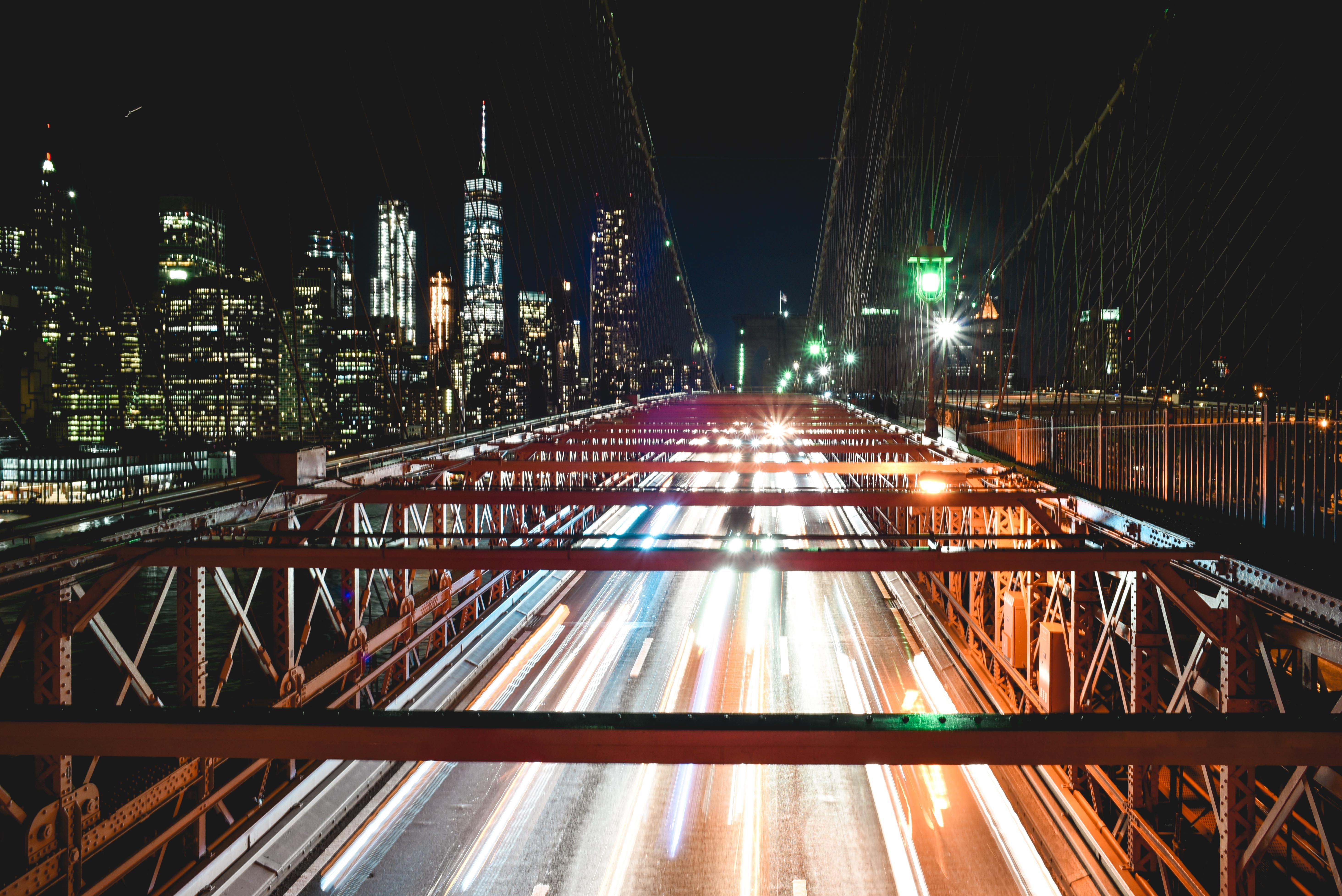 time lapse photography of moving vehicles on bridge