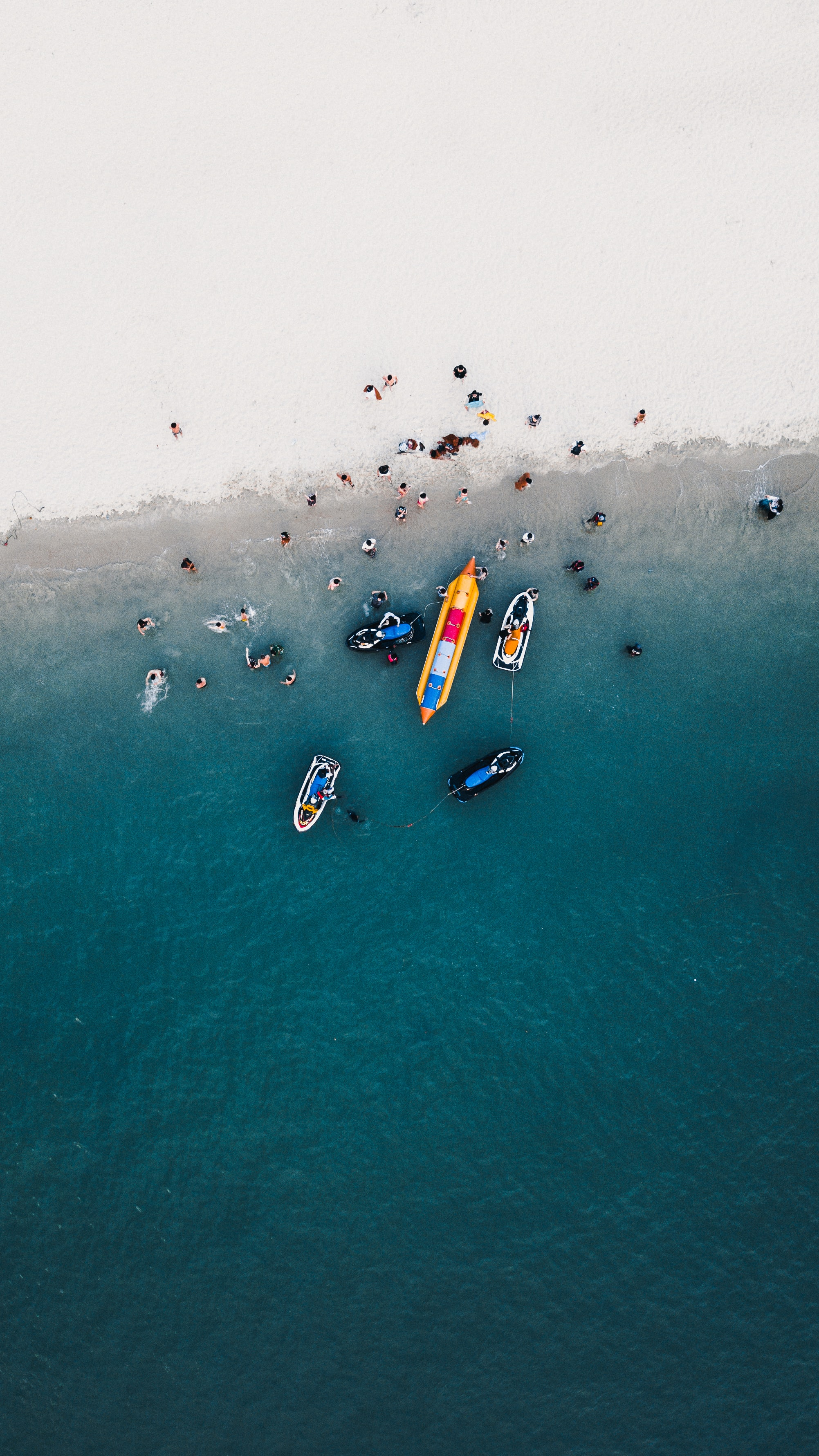 aerial photography of boats on seashore