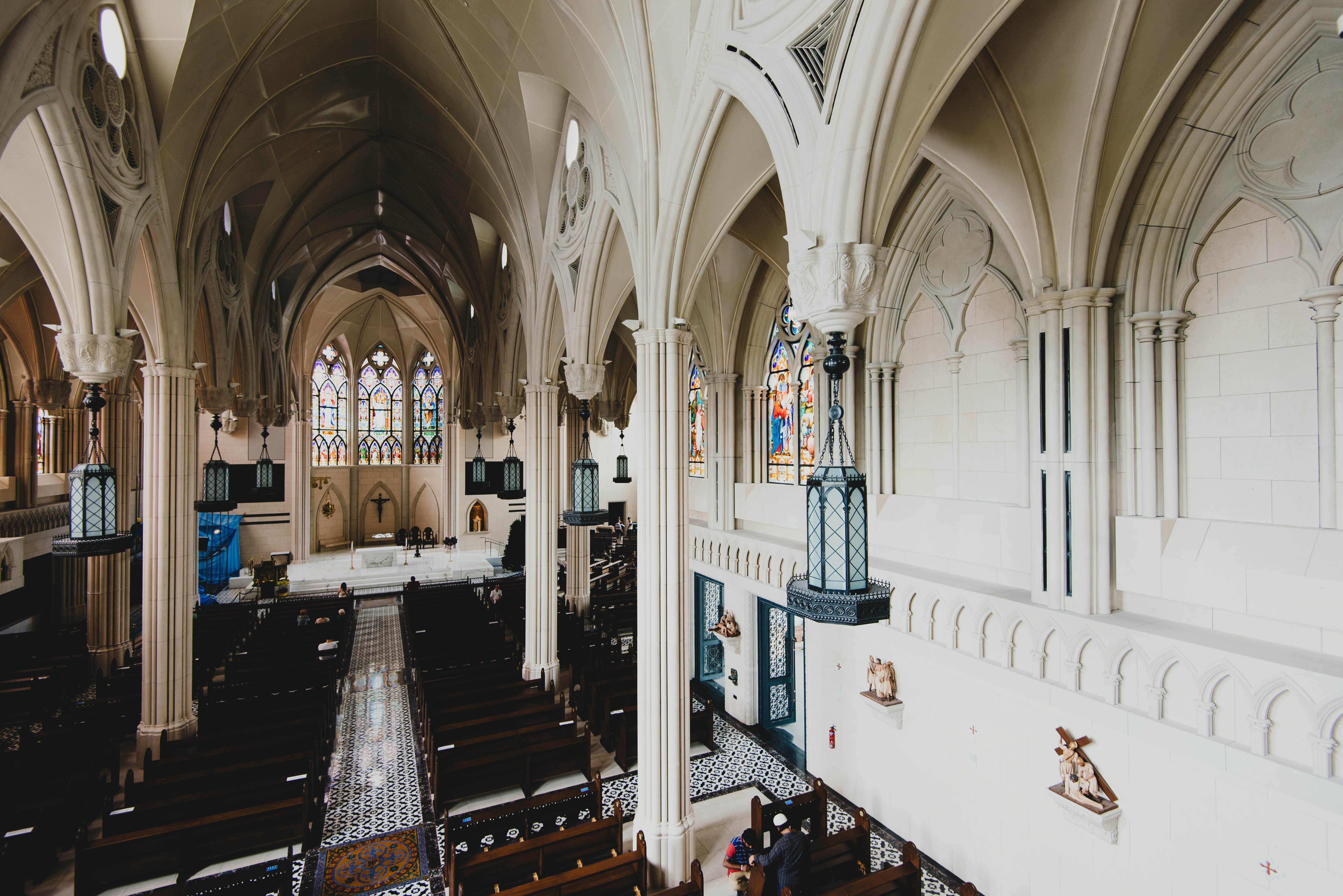 aerial view photography of brown wooden pew bench inside church