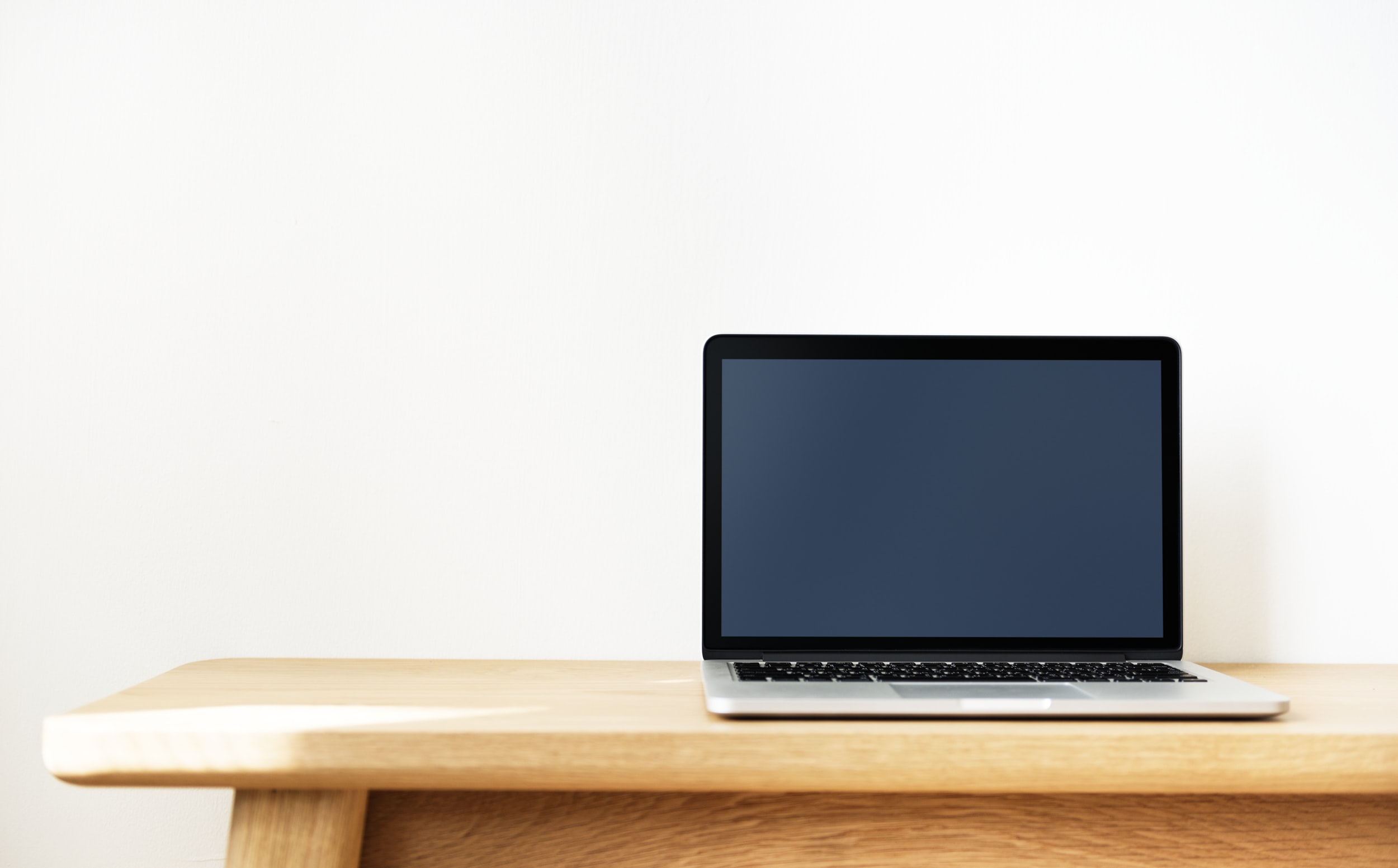 black and gray laptop computer on brown wooden table