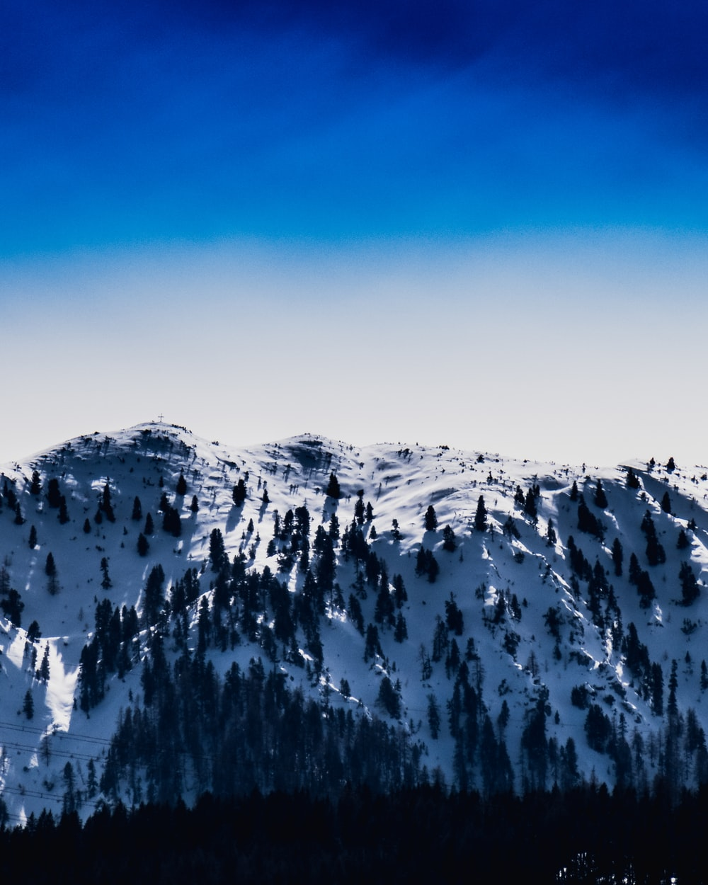 snow capped mountain under blue sky during daytime