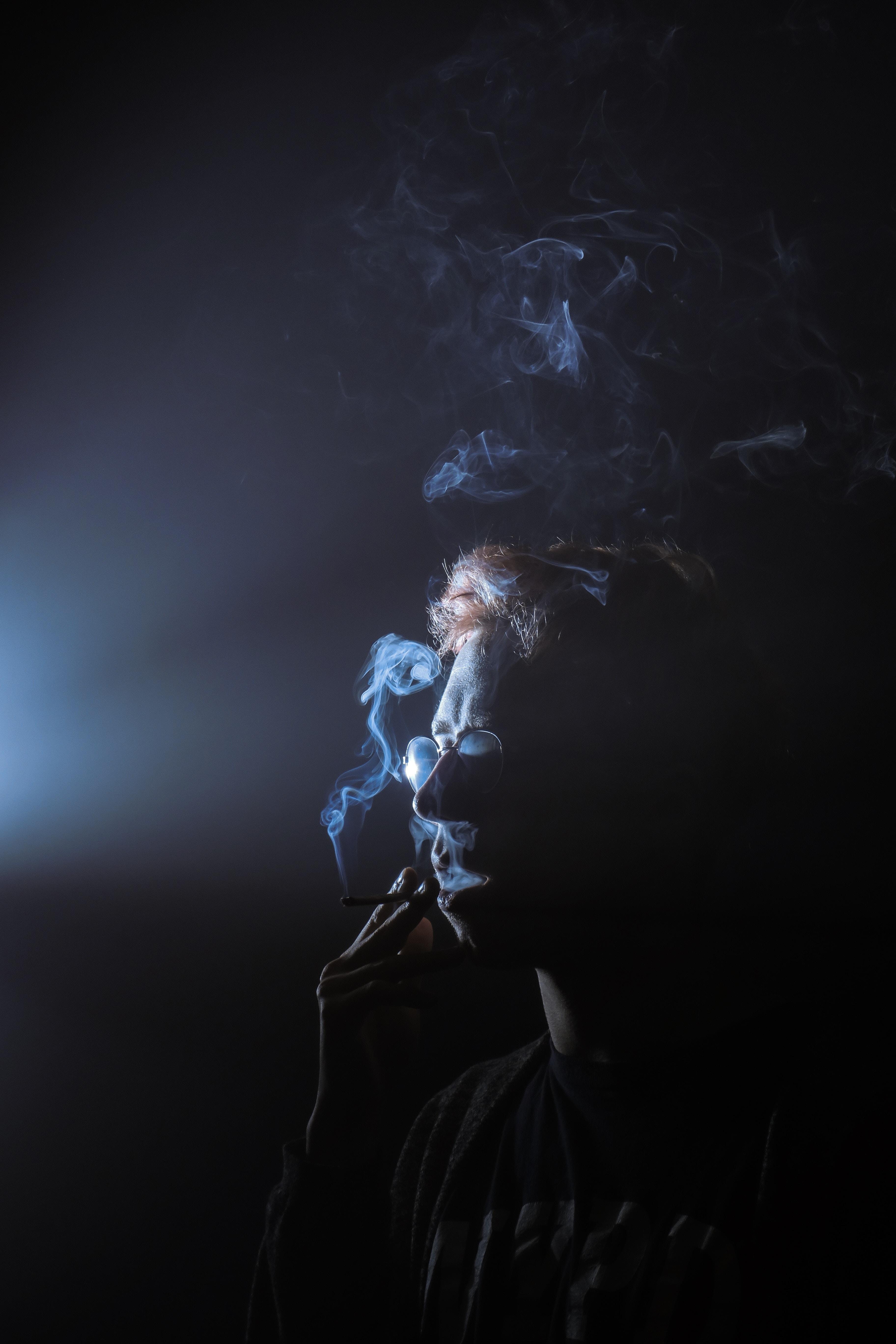 silhouette of smoking man
