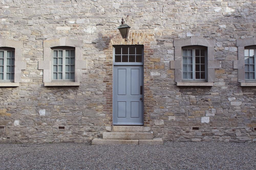 gray wooden 4-panel door closed