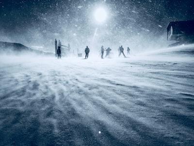 people walking during snow