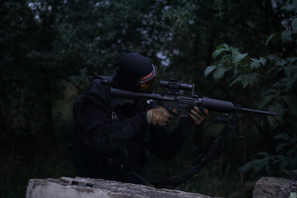 man holding rifle