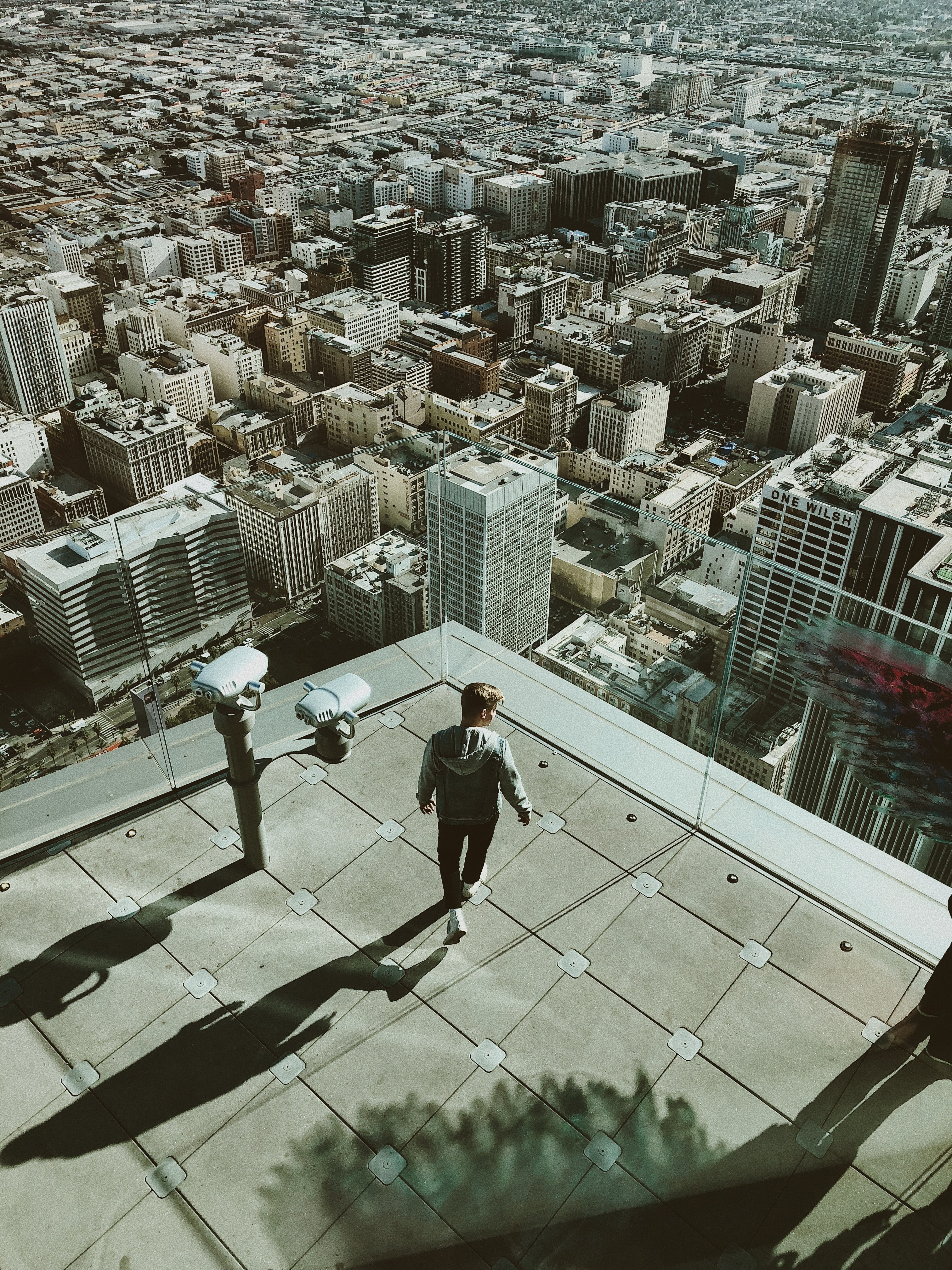 person standing on top of city building