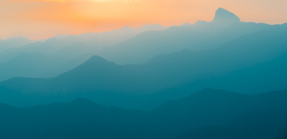 landscape photography of mountains with fog