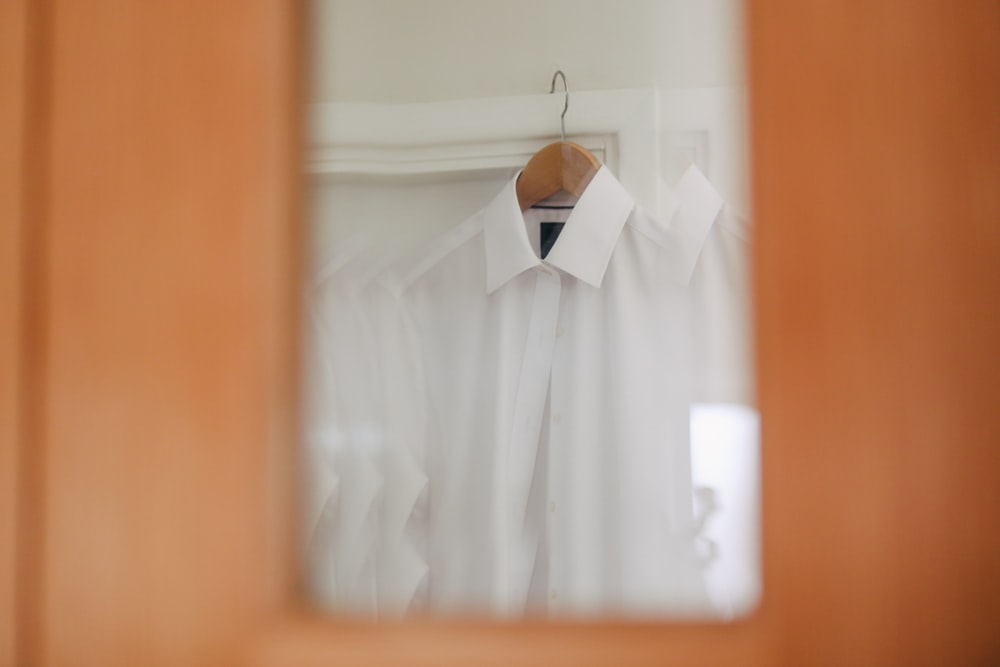selective focus photography of white dress shirt