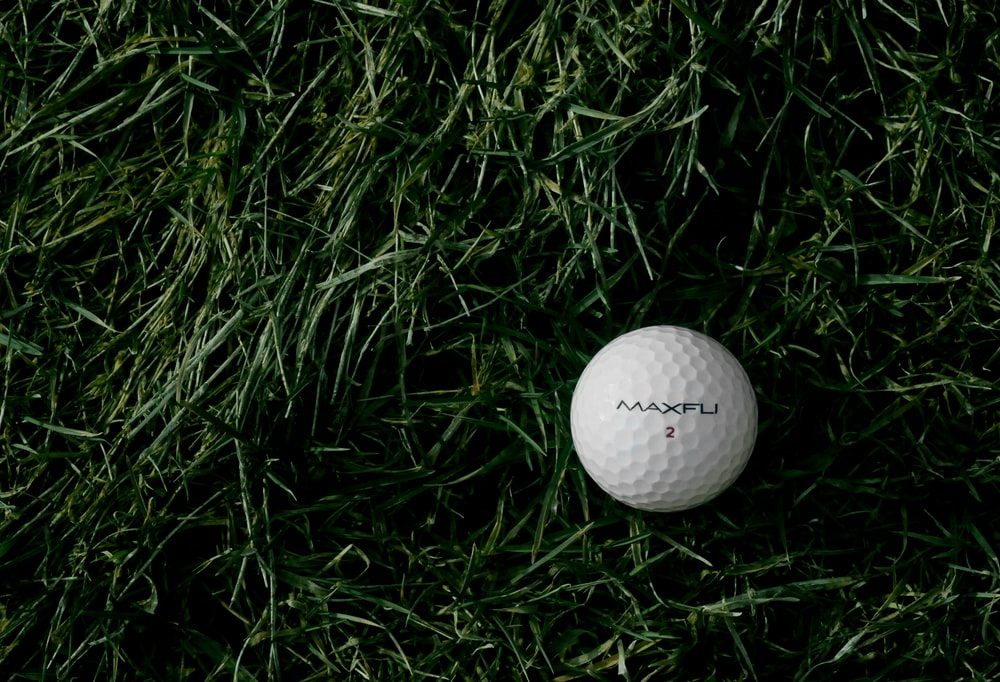 white Maxfu 2 golf ball on green grass