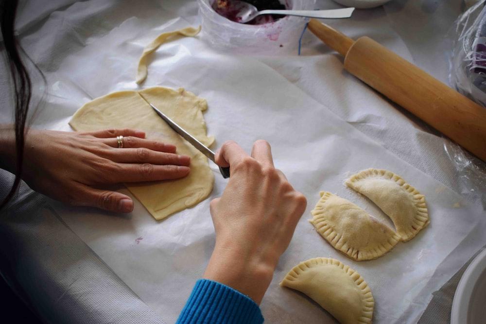 person making Empanadas