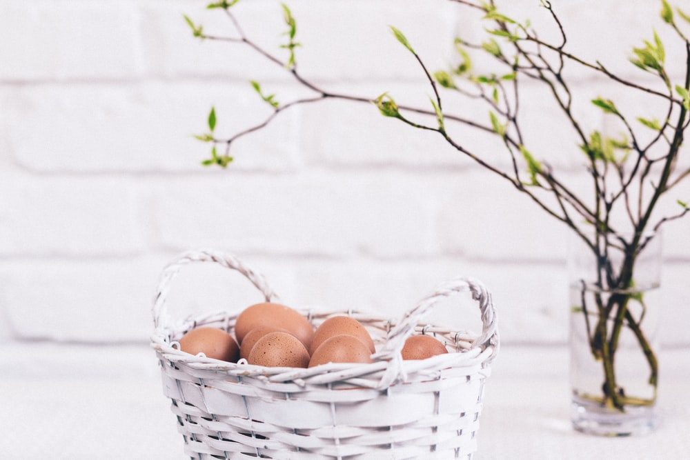 brown eggs on white basket