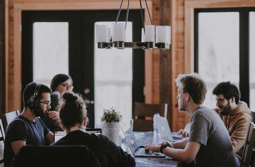 sittin people beside table inside room