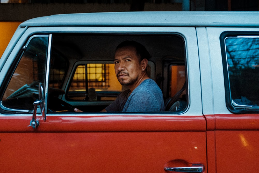 man driving inside the car