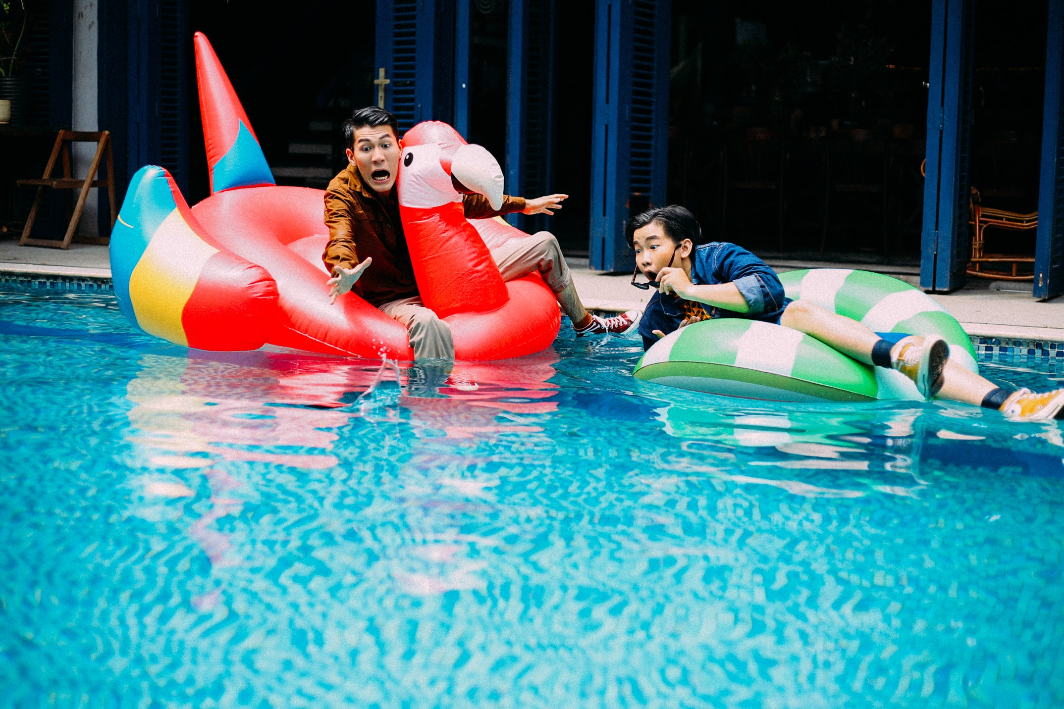 two men on pool float during daytime