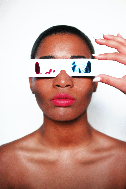 woman wearing 3D glasses taking selfie