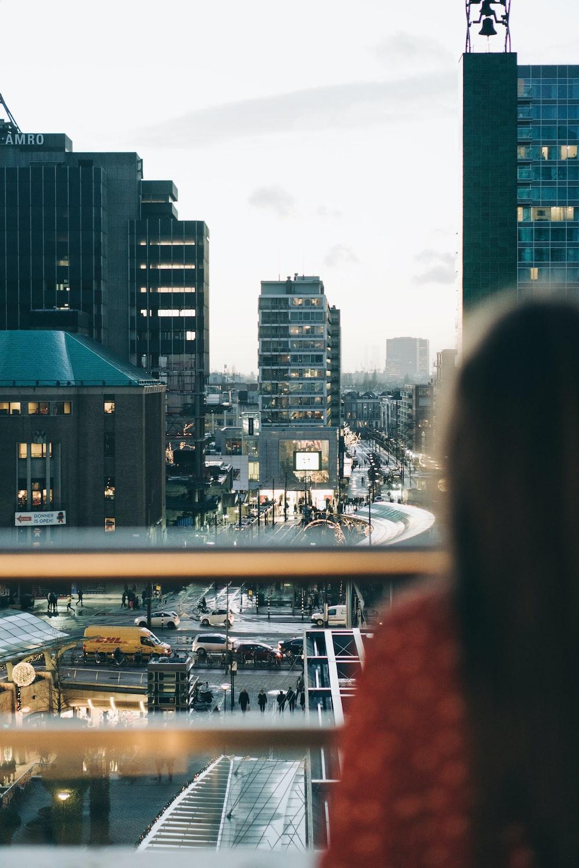 selective focus photo of woman facing buildings