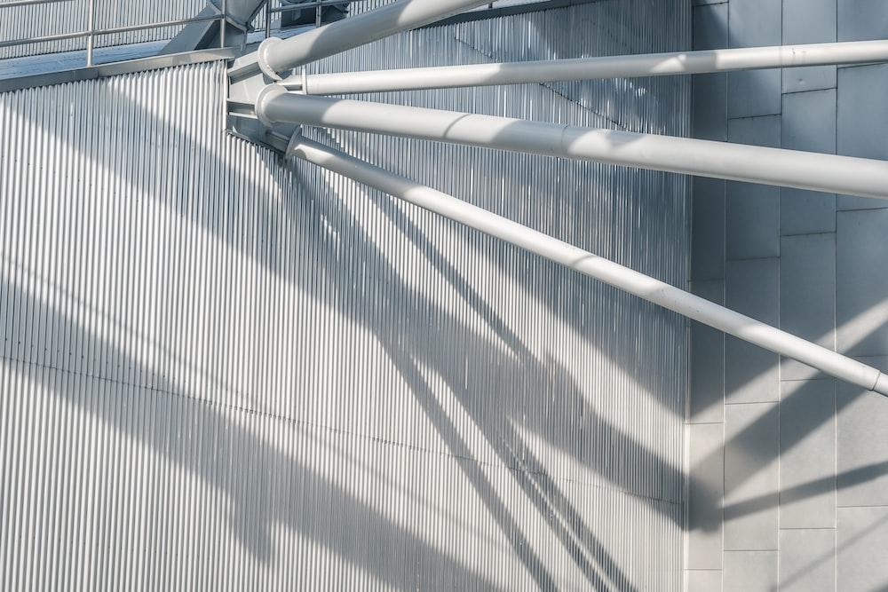 grey metal pipe at daytime