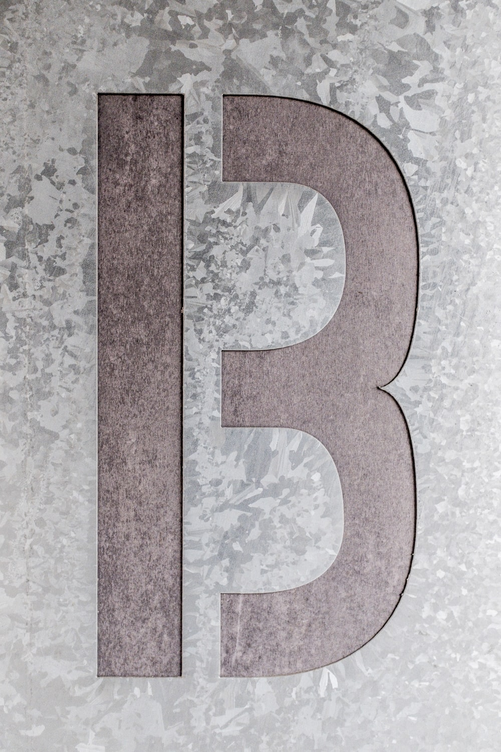 brown and grey letter B artwork