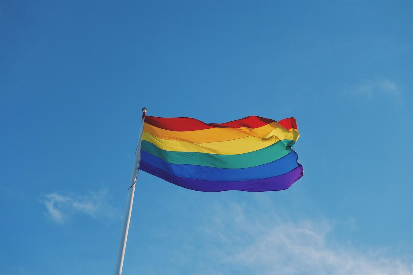 Pride flag against the sky