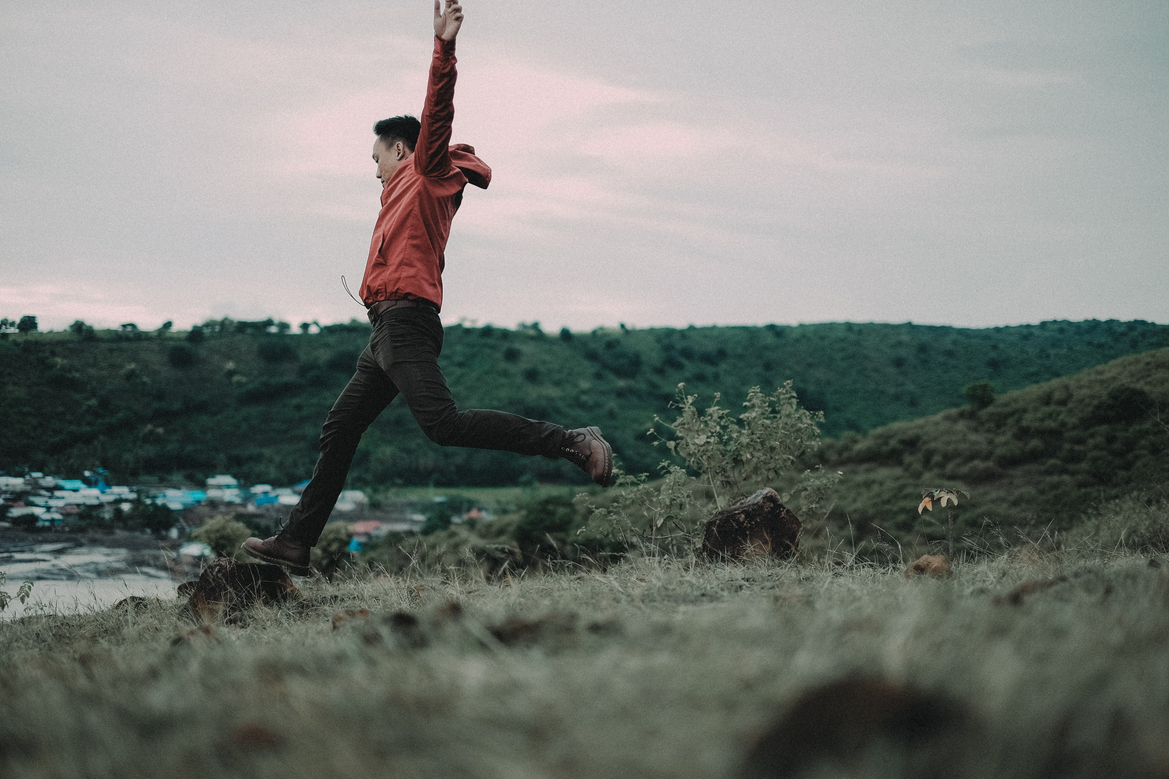 man jumping on green grass at day time