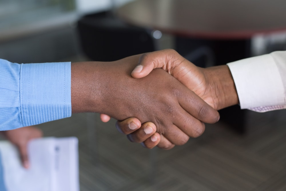 two person handshaking
